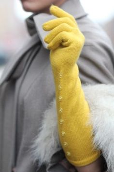 Yellow gloves pop against a grey coat. Tick Tock Vintage Fingerless perhaps? Shades Of Yellow, Grey Yellow, Mellow Yellow, Yellow Sun, Lemon Yellow, Bright Yellow, Orange, Cute Fashion, Vintage Fashion