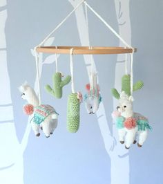 Make your own amazing Llama baby mobile with this simple crochet pattern. This crochet mobile would be the perfect addition to a boho styled babys nursery. It features three cute crochet Llamas with a colorful striped rug on their back and three pompoms. Their friendly faces will