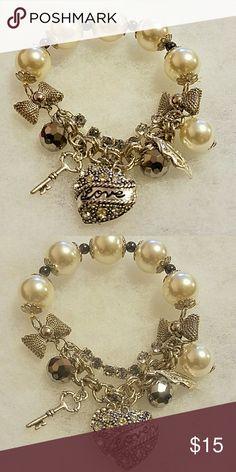 Pearl stretch bracelet with charms Charm bracelet Jewelry Bracelets