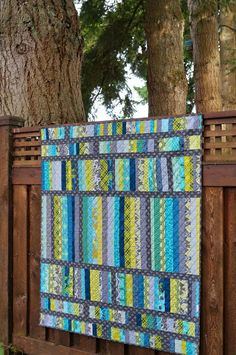 Scrap Attack Quilt | Hilltop House Creative Works quilted with a simple diagonal crosshatch - more ideas for a Jelly Roll Race layout