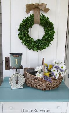 Screen porch - old door and table display Burlap hanging Christmas Wreath