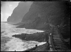 Section of the beach tramway between Karekare and Whatipu, Auckland. Photograph taken by Albert Percy Godber, between 1915 and This section . Nz History, Family History, Ho Chi Minh Trail, Auckland New Zealand, Beneath The Surface, Sense Of Place, Built Environment, Beautiful Images, Old Photos