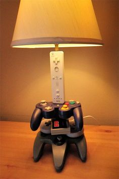 Nintendo controller lamp - You can't help but feel nostalgic (as a gamer) when looking at the Nintendo controller lamp. This lamp is exactly what it sounds like, a ligh. Video Game Bedroom, Video Game Rooms, Video Games, Boy Room, Kids Room, Deco Gamer, Boys Bedroom Decor, Geek Bedroom, Bedroom Ideas
