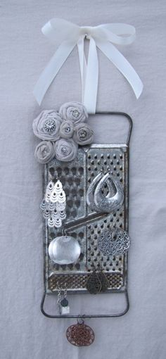 Earring organizer out of an old cheese grater, via HbernationRstoration at etsy.com. LOVE this one.