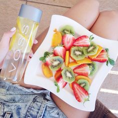 voss water with lemon fruits strawberries peach kiwi