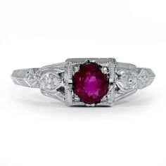 The Freida Ring from Brilliant EarthA mesmerizing natural ruby sits cushioned in a square-shaped setting detailed with fine milgrain in this Art Deco ring. Engraved details along the knife-edge shank add additional glamour (Ruby approx. 0.50 total carat weight).