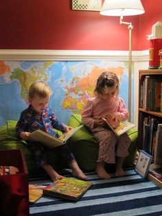 Oooh, a map at the bottom of the wall. #love Awesome little preschool reading nook! <3