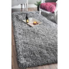 NuLOOM rug construction is sturdy and can stand the test of time. This shag area rug makes a fun addition to any fashionable space.