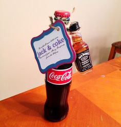 "Others received, ""We could all use a little extra JACK & COKE this time of year"" gifts with mini Jack Daniels tied to a glass bottle of Coca Cola. Description from belleannounces.blogspot.com. I searched for this on bing.com/images"
