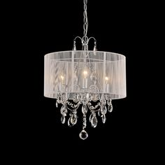 The white cotton thread and chrome crystal chandelier by Maury White creates an elegant combination to add style to any space. The delicate crystals are hung from chrome arms and surrounded by a sheer of white cotton threads to create the perfect look.