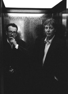 Paul and Elvis Costello. Is that an elevator? Imagine those doors opening in front of you.