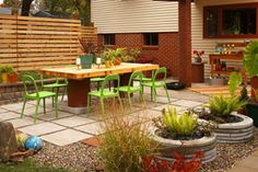 concrete slab tutorial. Like the stone planters, wooden tabletop and neon chairs.