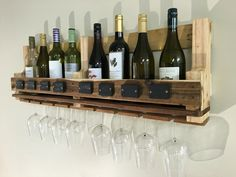 Pallet wine rack with chalkboard paint badge.