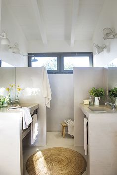 The bathroom too is a haven and oozes earthy charm with a walk in shower and toilet area. Sinks are found on adjacent walls and there is ample lighting, with wall-mounted fixtures, to maximise the lighting in this space.