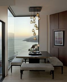What a view from this terrific dining room. Wonderful pendant lighting.