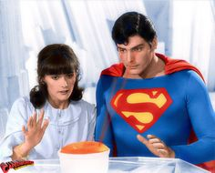 Christopher Reeve as Superman and Margot Kidder as Lois Lane have dinner