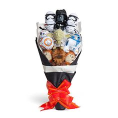 """For when you need an out-of-this-world way to say, """"I love you"""" or """"I know"""" or """"Utinni!!!,"""" we offer this Star Wars Bouquet. With Yoda, Darth Vader, Chewie, BB-8, R2-D2 + 2 Ewoks & 2 Stormtroopers, it features both good and bad guys."""