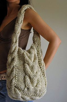 I combined here three things that I have weakness for: cable pattern, big and comfortable bag and earth-friendly materials. This original and one-of-a-kind bag will hold everything you need and even what you don't need! :)  It is completely handmade and my original design.  I knitted it with fantastic super bulky lamb-wool and acrylic blend. Lined with cotton fabric with double practical pocket - one for your cell phone and another for some fine bits and pieces.  The handle is reinforced…