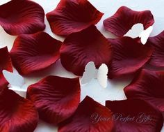 Lovely idea to add the white butterflies in with the rose petals!