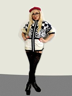 Wardrobe need some street cred? Kick things up a notch and add some retro hip hop flair to your closet. This ridiculously loud, flamboyant and bold black and white windbreaker will make you look like royalty. This jacket has a truly over the top, larger than life, rich, luxurious vibe. Checkerboard