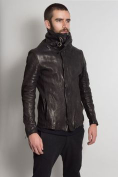 Incarnation   High neck leather jacket with strap.