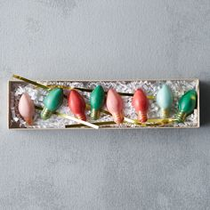 """Taking the shape of old-fashioned Christmas bulbs, these colorful candies from Lock and Key Confectionery are hand-crafted from white chocolate.- A terrain exclusive- Ingredients: sugar, partially hydrogenated palm kernel and cottonseed oils, cocoa butter, nonfat and whole dry milk, milk, glycerol lacto esters of fatty acids, soy lecithin, salt- Contains soy and dairy- Gluten free, vegetarian- Keep away from sunlight and heat- Shelf life: 3 months- Handmade in the USABox: 1""""H, 2""""W, 8""""L"""