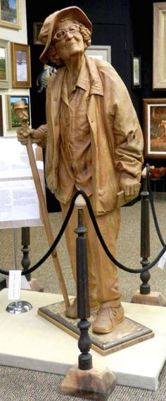 """A PENNY SAVED"" SCULPTURE WATCHES SUBWAY...wood sculptures by Fred Cogelow"
