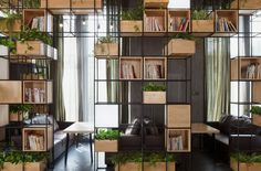 Beijing cafe fights pollution from the inside and makes ingenious use of its multiple modular shelving units. Get ideas for your own special place here!