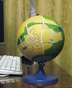 You are HERE ***   Cool idea...make your own local globe!: diy globe....Wouldn't this be a neat housewarming gift in a small scale?