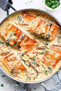 Creamy Garlic Butter Tuscan Salmon is a restaurant quality salmon recipe in a beautiful creamy Tuscan sauce! Pan seared Salmon in a creamy sauce filled with garlic, sun dried tomatoes, spinach and parmesan cheese. Packed with SO MUCH FLAVOUR!