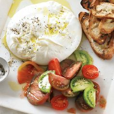 Using burrata, a mozzarella-type Italian cheese with a creamy center, makes this appetizer particularly decadent, but you could also use buffalo mozzarella or a soft goat cheese if you prefer. Italian Appetizers, Cheese Appetizers, Appetizer Recipes, Heirloom Tomatoes, Dried Tomatoes, Italian Cheese, Goat Cheese, Burrata Cheese, Burrata Mozzarella