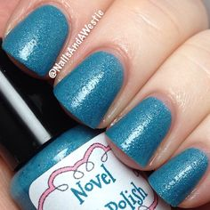 Novel Nail Polish 'Eyes of Wight'. 1 coat, with topcoat. Thermal (& slightly textured) polish that goes from teal when cold, to light blue when warm. It also glows blue in the dark! #nails #nailpolish #indiepolish #novelnailpolish #thermalpolish #glowinthedarkpolish