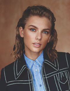 And she looks just as different in the photo shoot inside. Take this androgynous look, for instance.