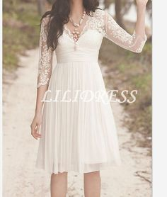 I like this dress.  Not for the formal occasion, but maybe for if we did do a dessert party where I can't wear the actual dress. - Chiffon kneelength beach wedding dresses Lace Wedding by LILIDRESS, $122.00