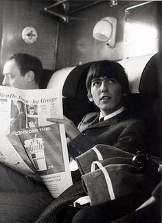 George Harrison on the train, reading a newspaper story about a Beatle twin?