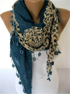 A lovely blue designed scarf a nice accessory to wear with a suit, dress, or casual wear.