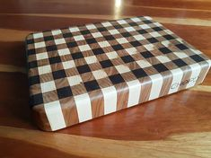This gingham pattern end grain cutting board is perfect for those with limited space but still looking for a high quality cutting surface. Made from Eastern Maple, Cherry, and Black Walnut; this cutting board is sure to last for many years to come. Dimensions: 13 Long 9-1/2 Wide 1-7/8 Thick