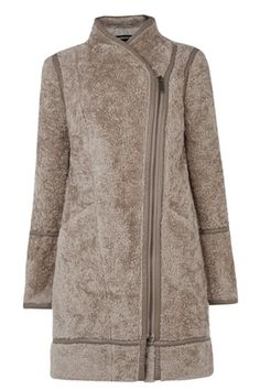 This on-trend coat is constructed from soft teddy style fabric and features leather look detailing, exposed asymmetric zip and two front patch pockets. Length of coat from shoulder seam to hem; 85cm approx. Height of model shown 5ft 10inches/178cm. Model wears: UK size 8.