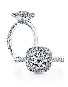 Jean Dousset Eva Round Cushion. Round brilliant cut diamond.