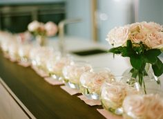simple centrepiece idea - blush pink roses floating in bowls