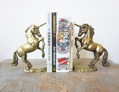 Every home could use some unicorn book-ends. And if the brass isn't fabulous enough for ya, you could always spray paint them :)