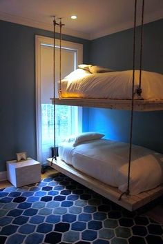 suspended bunk beds hanging by room for shared teen room