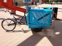 DPL Connect -- a pedal-powered mobile library and wi-fi hotspot provides free wireless internet access and is stocked with a rotating collection of books tailored to the bike's location (i.e. cookbooks and urban farming for farmer's markets, bike repair and Denver maps for bike trails, etc).
