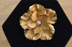 Pretty Vintage Faux Pearl, Gold tone Floral Brooch (P11) by Beadazzle27 on Etsy https://www.etsy.com/listing/222640890/pretty-vintage-faux-pearl-gold-tone