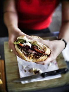 Biting into an awesome Aussie-style burger in Noosaville, Queensland, Australia