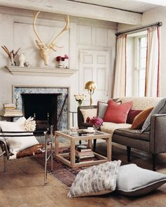 chic antler over fireplace {via domino}