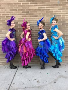four of our six Bird Girls with feathered headpieces and tails and their fabulous sequin applique dresses
