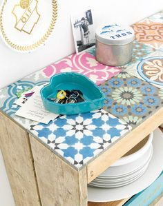 cover top shelf with assorted tiles