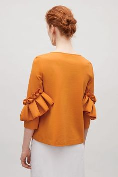 COS image 9 of Top with frill detailed sleeves in Orange