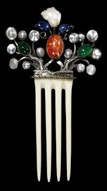 Vintage Hair Comb by Hodel Joseph, ca. 1906. Composed of ivory, mounted in silver and set with mother-of-pearl, sapphires, green stained chalcedony and a fire opal matrix.